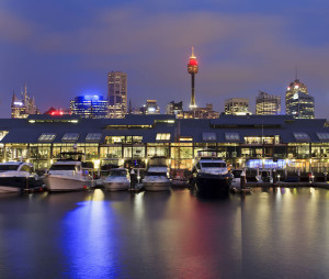 sydney pyrmont bay view on docks with marina boats at sunrise sydney tower above roofs of apartments